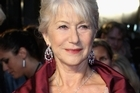 Dame Helen Mirren, at the London premire of The Debt, regrets being snapped in a red bikini in 2008. Photo / Getty