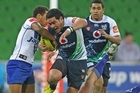 Konrad Hurrell fights his way through the Junior Bulldogs' defences. Photo / Getty Images
