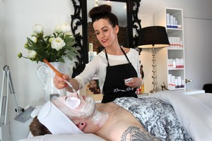 Beauty therapist Adrienne McDermaid treats Kurt Counsell to a facemask. Photo / Janna Dixon