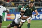 South Africa's Danie Rossouw is tackled by Fijian defence. Photo / Paul Estcourt