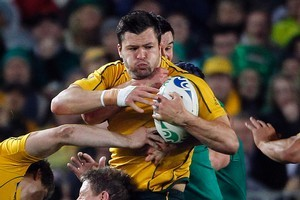 Adam Ashley-Cooper of the Wallabies is held tight. Photo / Sarah Ivey