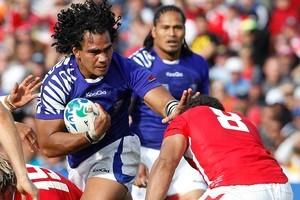 Samoan Maurie Faasavalu pushes through Wales no.8 Toby Faletau. Photo / Christine Cornege