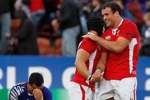 Wales players Leigh Halfpenny and Jamie Roberts celebrate after beating Samoa. Photo / Christine Cornege