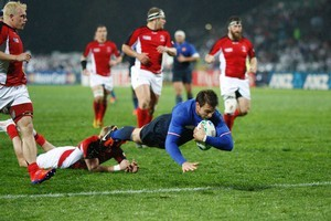 French winger Vincent Clerc scores against Canada in Napier last night. Photo / Richard Robinson