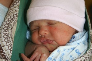 Newborn baby in a sling. Photo / Creative Commons License