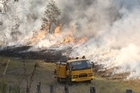 Authorities say high temperatures and strong winds mean that the risk of grass fires taking hold is significantly increased. Photo / Courier Mail