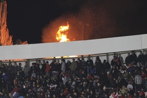 A small fire during in action during the Japan and Tonga Rugby World Cup 2011 game at the Northland Events Centre in Whangarei tonight. Photo / Greg Bowker