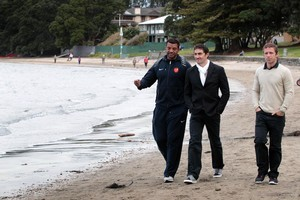 The French coaching staff - backs coach Emile Ntamack, Julien Deloire (trainer) and Vincent Krescher (video analyst) enjoy a walk along Takapuna Beach. Photo / Sarah Ivey