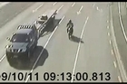CCTV footage of moments before a female cyclist critically injured on Sat Sept 10  The above second frame shows the black Nissan Navara towing the trailer (11.4m long) which was involved in the collision. Photo / Supplied