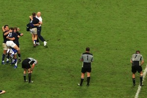 France celebrate and the All Blacks despair after the final whistle in 2007. Photo / Getty Images