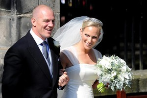 England rugby player Mike Tindall and Zara Phillips emerge after their wedding on July 30, 2011. Photo / AP