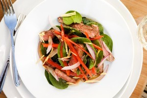 Ginger soy beef salad with mirin and greens. Photo / Babiche Martens