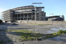 Sludge caused from liquefaction surrounds AMI Stadium again after a series of aftershocks in June. Photo / Greg Bowker