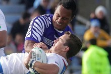 Eliota Fuimaono-Sapolu tackles Theuns Ktoze during Samoa's first Rugby World Cup 2011 match against Namibia in Rotorua. Photo / Alan Gibson