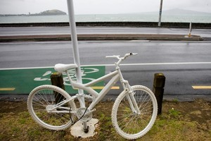 The white bike was parked opposite the part of Tamaki Drive where 27-year-old cyclist Jane Bishop died after a collision with a truck. Photo / Dean Purcell