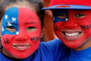Samoa fans such as Emma Huch, 9 (left), and Moanekah Va'ai 10, will be out in force or glued to their TV sets for their team's keenly awaited encounter with Fiji tomorrow.  Photo  / Christine Cornege