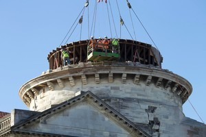 Engineers prepare the internal pressed copper dome from the Catholic Cathedral for removal from the Basilica. Photo / Simon Baker