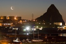 A night view of New Plymouth's Paritutu Rock and Port Taranaki. Photo / Mark Mitchell