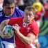 Shane Williams of Wales tries to run through the tackle of Kahn Fotuali'i of Samoa. Photo / Alan Gibson