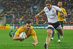 Wing Adam Ashley-Cooper of the Wallabies dives over the line to score his team's seventh try. Photo / Getty Images