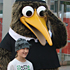 Fans snap photos with a mascot. Photo / Edward Golausee