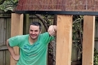 Justin Newcombe takes a break from constructing his Samoan-style fale in an Onehunga backyard. Photo / Sarah Ivey