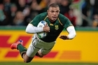 South Africa's winger Bryan Habana scores to set a South Africa try-scoring record with his 39th try. Photo / Brett Phibbs