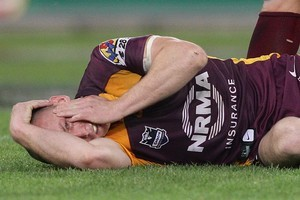 Darren Lockyer of the Broncos goes down after taking a knock in the head. Photo / Getty Images