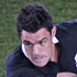 Dan Carter drop-kicks the ball up the field. Photo / Richard Robinson