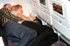 New economy class seats allow passengers to lie down.