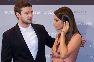 Justin Timberlake and Mila Kunis have denied reports that they've been sexting each other. Photo / AP