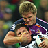 Jacob Lillyman of the Warriors is tackled by Todd Lowrie of the Storm. Photo / Getty Images