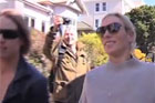 Zara Phillips and Mike Tindall are swamped by paparazzi while out and about in St Clair in Dunedin.