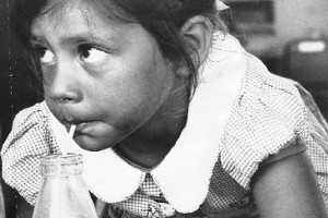 A new entrant takes comfort in her school milk in 1967. Photo / NZ Herald