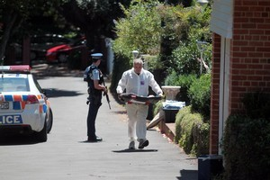 Armed police were still at the Mt Albert property yesterday even after a man was charged with murder. Photo / Doug Sherring