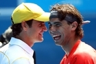 Rafael Nadal and Roger Federer at the Rally for Relief in Melbourne yesterday. Photo / Getty Images