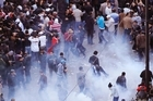 Police throw tear gas during a demonstration in Tunis. Photo / AP