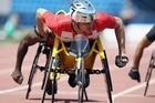 Marcel Hug of Switzerland races in the Men's 800m T54 race. Photo /Getty Images)