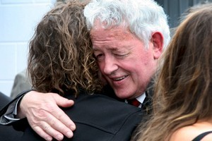 Bernie Monk embraces a supporter after a  memorial service for his son Michael. Photo / Herald on Sunday
