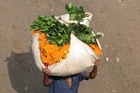 Marigolds arriving at the Malik Ghat flower market. Photo / Jill Worrall