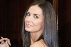 Demi Moore, 48, has allegedly undergone over $400,000 worth of surgery. Photo / Getty Images