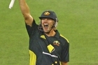 Shane Watson celebrates after hitting the game winning runs. Photo / Getty Images