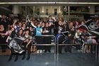 Warriors fans gather to welcome home the team at Auckland International Airport. Photo / Getty Images