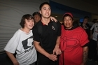 Shaun Johnson of the Warriors poses with fans at Auckland Airport. Photo / Getty Images