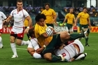 Salesi Ma'afu of the Wallabies maintains possesion to touch over and score their eighth try. Photo / Getty Images
