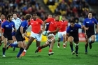 Viliami Ma'afu of Tonga splits open the France defence. Photo / Getty Images