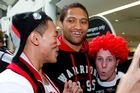 Warriors player Manu Vatuvei gets his photo taken with fans before flying to Sydney for the NRL grand final. Photo / Dean Purvell