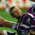 Lewis Brown of the Warriors gets the ball down under pressure from Beau Champion of the Storm. Photo / Getty Images