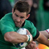 Fergus McFadden of Ireland is tackled by Denis Simplikevich of Russia. Photo / Alan Gibson