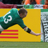 Keith Earls of Ireland dives in for a try while Russia's Denis Simplikevich tries to tackle him. Photo / Alan Gibson